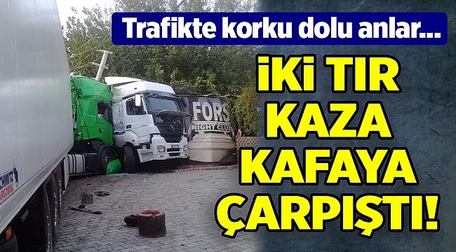 İzmir'de TIR kazası... İş yerine girerek durabildiler...