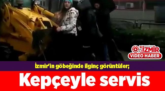 İzmir'in göbeğinde ilginç görüntüler; Kepçeyle servis