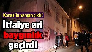 İzmir Konak'ta yangın çıktı! İtfaiye eri baygınlık geçirdi