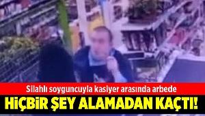 İzmir'de silahlı soyguncu kasiyer direnince kaçtı
