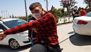 Kalpazanlar kendilerini görüntüleyen kameramana saldırdı