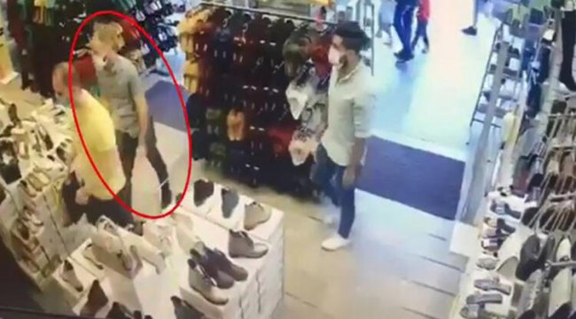 Ayakkabı mağazasında müşterinin telefonunu çalan şüpheli kamerada