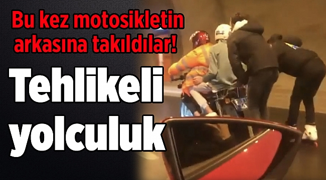 Tehlikeli yolculuk: Bu kez motosikletin arkasına takıldılar!